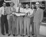 Group of men with large rainbow trout, Santa Fe, New Mexico