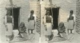 Women displaying pottery, Isleta Pueblo, New Mexico