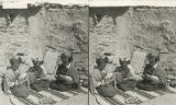 Hopi girls weaving baskets, Shipaulovi, Arizona