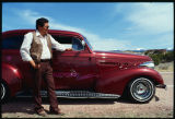 Man with lowrider car, Good Friday pilgrimage to El Santuario de Chimayo, New Mexico