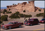 Group of red lowrider cars, Good Friday pilgrimage to El Santuario de Chimayo, New Mexico