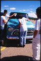 Family polishing lowrider at car show, Santa Fe, New Mexico
