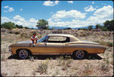 Jimmy Martinez's nephew with lowrider car, New Mexico