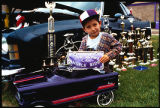 Boy in pedal car at lowrider car show, Las Vegas, New Mexico