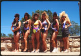 Female beauty contestants at lowrider car show, Las Vegas, New Mexico