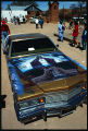 Lowrider car with hood painting of Jesus and church, Good Friday pilgrimage to El Santuario de...