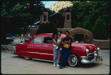 Victor Martinez and family with his lowrider car, El Santuario de Chimayo, New Mexico