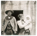 Couple with baby (perhaps Pena family), Nambe Pueblo, New Mexico