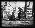 Children playing in yard, New Mexico