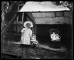 Unidentified girl with dolls, Las Vegas, New Mexico