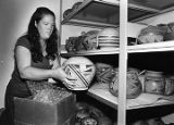 Assistant curator Laurel Seth unpacking pottery, Laboratory of Anthropology, Santa Fe, New Mexico