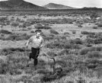 Policeman with bloodhound searching for escapees near Penitentiary of New Mexico, Santa Fe, New...