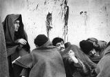 Inmates in yard huddled against the cold following February 2 and 3 riot, Penitentiary of New...