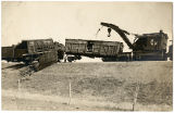 Crane moving Atchison, Topeka and Santa Fe Railroad cars after accident, New Mexico