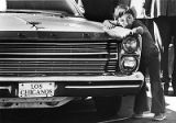Young boy at car show admiring customized 1965 Ford, Santa Fe, New Mexico