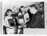 Display photo from Santa Fe Boys' Club showing reverend Henry F. Seaman with basketball players,...