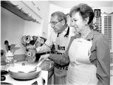 Abe and Marion Silver making potato pancakes for Chanukah, Santa Fe, New Mexico