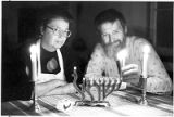 Dee and Dale Barber lighting the first candle of Chanukah, Santa Fe, New Mexico