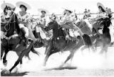 Members of Charros las Alazanas demonstrating horsemanship, Santa Fe, New Mexico