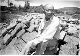 Jess Mermejo with original adobe bricks salvaged from 200 year old mission church, Picuris Pueblo,...