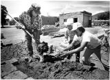 Tribal members making adobe mortar for church restoration, Picuris Pueblo, New Mexico