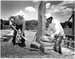 Tribal members restoring foundation of church, Picuris Pueblo, New Mexico