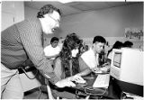 Teacher Richard Rubinstein helps student Shannon Rivers in computer class, Santa Fe High School,...