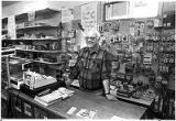 Proprietor George Adelo at his country store, Pecos, New Mexico