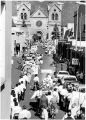 Procession on San Francisco Street carrying La Conquistadora back to Saint Francis Cathedral,...