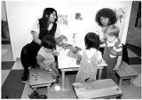 Susan Farley and Julie Stuart do children's activities at Vivigen Inc. daycare center, Santa Fe,...