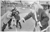 Artist Tommy Macaione on the Plaza dressed as Santa Claus, Santa Fe, New Mexico