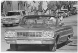 Santa Claus in a 1964 Chevrolet convertible on Lincoln Avenue, Santa Fe, New Mexico