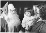 Santa Claus visiting with child and her mother, Santa Fe, New Mexico