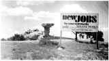New Jobs sign at Camel Rock, Tesuque Pueblo, New Mexico