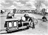 Carnival workers setting up children's circus train, Santa Fe, New Mexico