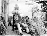 Artist Tommy Macaione giving man a haircut on Camino del Monte Sol, Santa Fe, New Mexico
