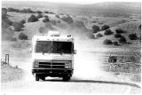 Recreational vehicle on gravel road near Santa Fe, New Mexico