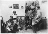 Painter Kenneth Adams of Taos Society of Artists with models in his studio, Taos, New Mexico