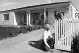 Journalist Ernie Pyle talking with neighbor at his home on Girard Avenue, Albuquerque, New Mexico