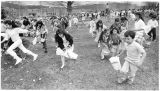 Children hunting for Easter Eggs during the annual Jaycees event, Santa Fe, New Mexico