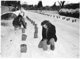 Preparing farolitos in the Canyon Road Acequia Madre neighborhood on Christmas eve, Santa Fe, New...