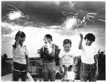 Boys celebrating July 4th, with fireworks, Santa Fe, New Mexico