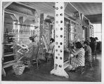 Women in weaving class making rugs, New Mexico