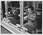 Women in weaving class making a Hopi ceremonial sash, New Mexico