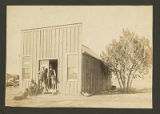 Men in front of unidentified building, New Mexico