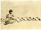 Artist Maria Martinez with display of her pottery, San Ildefonso Pueblo, New Mexico