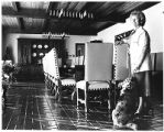 First Lady Alice King and dog Missy in the dining room of the Governor's Mansion, Santa Fe, New...