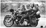 Motorcyclists cheer participants in Hands Across America, a campaign to fight hunger and...