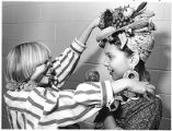Blanch Kraai, left, adjusts the Halloween costume of Xochito Lucero, Kaune Elementary School...