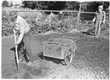 Luis Perea reconditioning garden soil after fall harvest, Santa Fe, New Mexico